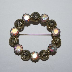 Vintage gold and AB crystal circle brooch